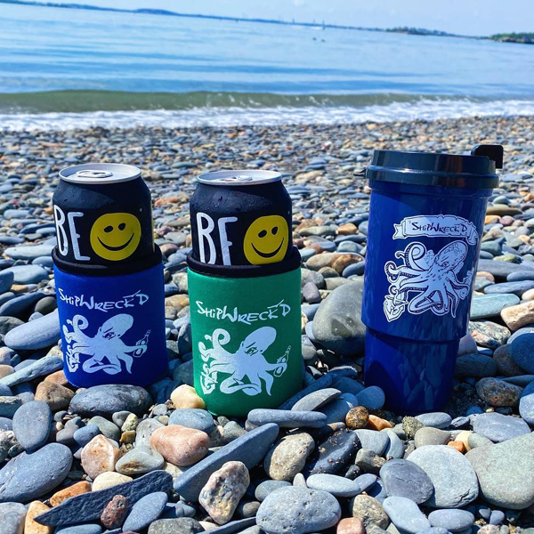 shipwreckd coozies in blue and green and blue shipwreckd coffee travel mug
