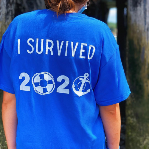 back view or royal blue shipwreckd shirt that says i survived 2020